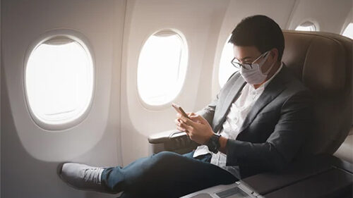 Man sitting in airplane.
